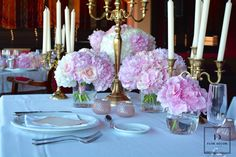Wedding table decorations of roses, hortensias and peonies.