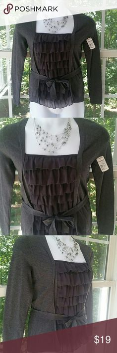 """🆕Apt 9 Charcoal Grey Elegant Sweater This gorgeous sweater will not only keep you warm but also in style! You will feel like a model when wearing it! Ruffled front with a waist tie. Elegant, classy, and fashionable.  Bust 17"""", length 22 1/2"""". Thank you for looking! Xoxoxoxo Apt. 9 Sweaters Crew & Scoop Necks"""