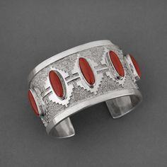 Cuff | Tommy Jackson (Navajo).  Sterling Silver and Natural Red Coral