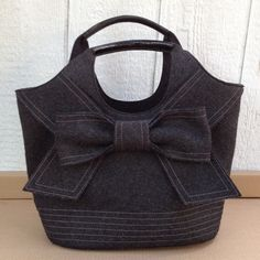 Kate Spade bow bag Gray felt with black patent leather handles. Used a few times NO TRADES kate spade Bags