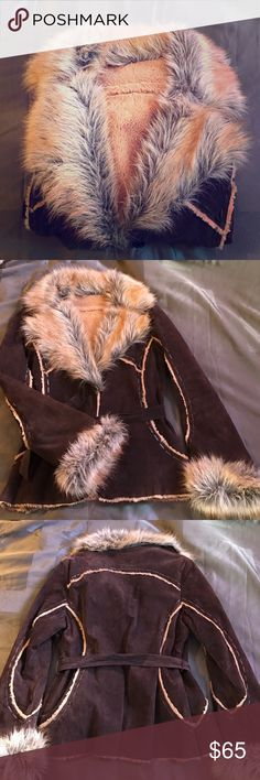 Wilsons Leather jacket Beautiful jacket and very warm. Nearly in New condition. Soft leather shell with warm fuzzy faux fur on the inside. Dark brown in color. Wilsons Leather Jackets & Coats