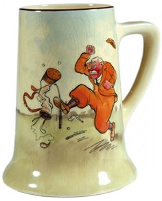 BATEMAN, H.M. Royal Doulton ceramic golfing mug, decorated with a coloured caricature of a red-faced irate golfer kicking his golf bag and causing amusement to other golfers. #antique #ceramics  [c.1920s].