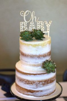Oh Baby, this cake topped with succulents and super cute cake topper is simple and gorgeous.