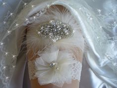 A personal favorite from my Etsy shop https://www.etsy.com/listing/260171138/rhinestone-wedding-garter-set-with