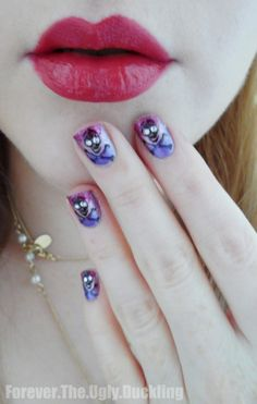 Pirate Nails... pretty with florals ^_^ great for a little spice when going to concerts (which I love to do a lot)