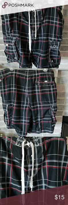 Swim Trunks Men's swim trunks by OP black, red grey. Fully lined. Two pockets close to the waist. Two Velcro pockets on the sides and a Velcro pocket on the back. These have been gently used. Only sign of wear is on the string in the front see photos. Sold as is. OP Swim Swim Trunks