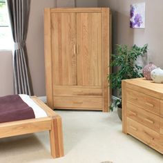 The Atlas solid Oak collection captures the popularity of oak furniture, featuring chunky oak construction complemented with contemporary lines and a soft satin lacquer finish emphasising the character of the oak grain. Simple yet stunning, moder Wardrobe Sale, Double Wardrobe, White Bathroom Furniture, Bedroom Furniture, Classic White Bathrooms, Garden Furniture Sale, Bedroom Storage, Traditional Design, Solid Oak