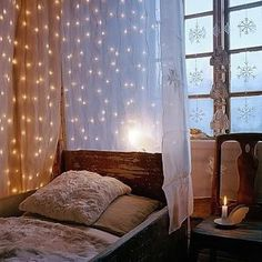 Hang fairy lights between layers of sheer fabric to create a secluded hideaway in your bedroom.