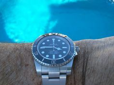 Rolex Submariner 114060 (No Date) - my first Rolex, with a few pictures