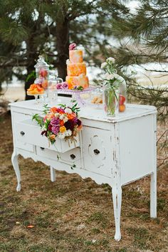 From A Vintage Affair Rentals  Antique dresser with vintage flowers and as cake display. Fabulous!