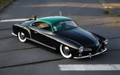 """The Volkswagen Karmann Ghia isn't just a head-turner — it's a historical artifact.  It represents the German marque's first attempt at building a """"dream car,"""" and — as evidenced by this special Green Hornet edition, which was painstakingly restored by French autophile Adrien Faure — it remains  a fairly good example of that to this day.  Might wanna keep that exposed engine out of the rain"""