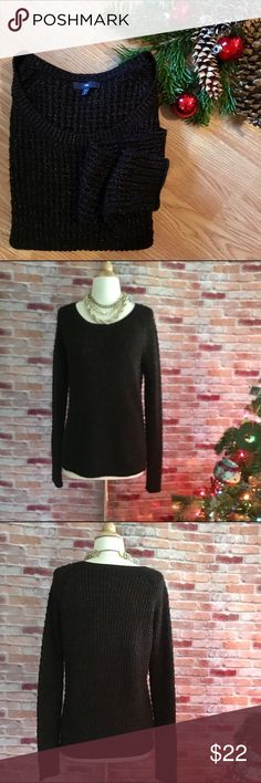 "GAP black knit sweater with gold shimmer Perfect for the holidays and beyond! Black wool blend knit sweater with bronze shimmer running throughout. Slightly scooped neckline. In good preloved condition. 70/12/8/5/5 acrylic, wool, poly, metallic, nylon.27""L. 20"" bust laying flat. Size medium. GAP Sweaters Crew & Scoop Necks"