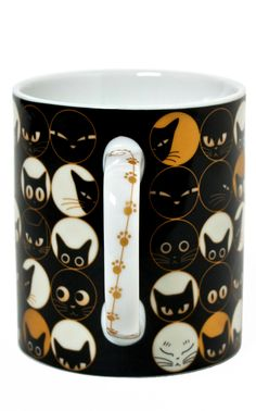 Cat Eye Mug. I def need this. Our cat Eliza is the queen of the stare.