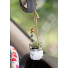 Discover cute car accessories at Natural Life! Deck out your car with adorable car stuff like steering wheel covers, hanging faux succulents and air fresheners!