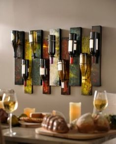 Another alternative to a storing wine bottles. This is, of course, presuming they last long enough to remain decor.| Offset Panel Wine Bottle Holder | Kirkland's
