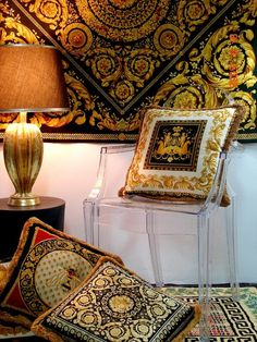 versace home.  love the ghost chair tucked in
