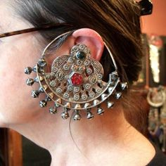 Halter Ethnic Jewelry : I have the pleasure to show this splendid pair of earrings from yomud tribes (Turkmenistan): these earrings are in silver and gildings and glasspasta (the red one in the center is an intaglio with probably the cosmogony)...the picture has the advantage to show the way these ornaments were worn around the ear and in the hair ...these great earrings date from the late 19th c  and are in perfect state which means that they were worn only in the great occasions ...