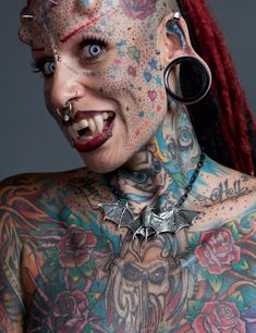 "Maria Jose Cristerna, known as the ""Vampire Woman"" because of her extreme body modifications, including hundreds of tattoos, skin implants, and permanent fangs 