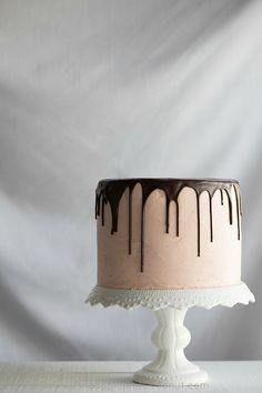 Chocolate Vanilla Tuxedo Cake with Raspberry White Chocolate Buttercream | from @Pineapple and Coconut | Shanna S