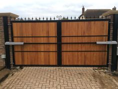 Rear of driveway gate showing above ground, electric automation. Electric Driveway Gates, Driveway Entrance, Electric Gates, Wooden Gate Designs, Wooden Gates, House Gate Design, Door Gate Design, Front Yard Fence, Fence Gate
