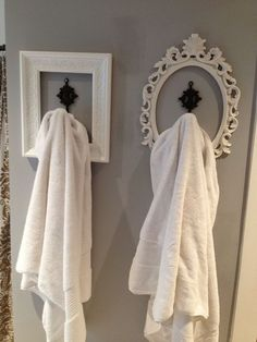 Single bathroom hooks, each one uniquely framed.  Neat idea!