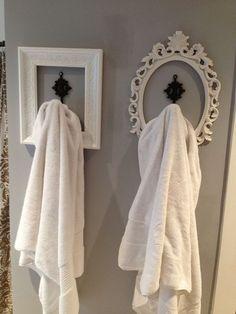 Single bathroom hooks, each one uniquely framed. Neat idea!
