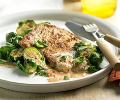 Pork with brussels sprouts - 4 1/2-inch-thick boneless pork chops 1/4 cup all-purpose flour 2 teaspoons paprika or smoked paprika 1 pound Brussels sprouts, trimmed and halved 2 tablespoons butter 1 8 - ounce carton light sour cream 2 tablespoons milk or half-and-half 1 teaspoon packed brown …