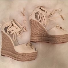 HOLIDAY SALE  100% Auth Cream Suede Gucci Gorgeous, cream and gold Gucci wedges. Worn once at function. FAB lightly used condition. 100% authentic. The shoe laces in the front have a little splitting on them-one string piece has broke but does not hinder tieing at all. It's just a suede piece. These are fabulous and very comfortable to wear. Come with dust bag. I will not negotiate price on my feed, only via the offer button. Shoot me an offer!!!! You'll love these!!! Open to reasonable…