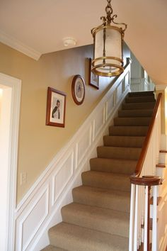 Light fixure          Sherwin Williams - Whole Wheat. Great neutral color, thinking rental side with white trim.