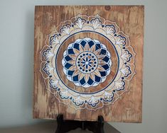 Size approx 12X12 Pine wood. Complete with Hanging hook on the backside. Navy, Gold and White Mandala on distressed Pine with Special Walnut