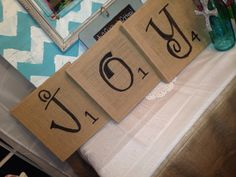 DIY arts and crafts, DIY burlap canvas, JOY, scrabble letters. I did this as scrabble letters and J-Jesus O- others Y-you. I counted my family in the You part so that's the reason for 4!