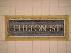 Mosaic sign on Fulton Street/Broadway – Nassau Street (New York City Subway) station. New York Subway, Nyc Subway, Nyc Train, Fulton Street, Places In New York, Empire State Of Mind, Nyc Restaurants, Street Names, Subway Tiles