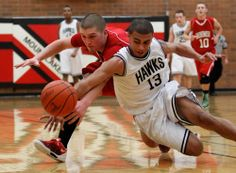 Snohomish's Josh Baird (left) goes to the floor with Mountlake Terrace's Isaiah Green (13) for a loose ball in the second quarter.