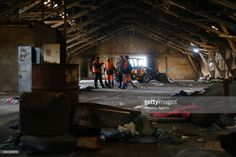 Serbian municipal employees demolish abandoned train station, sheltered by refugees for a while after refugees relocated to the reception of refugees in Belgrade, Serbia on May 12, 2017.