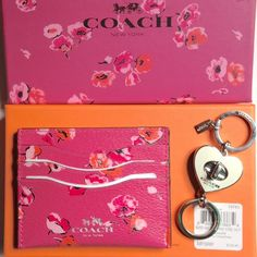 "Coach leather cardholder/keychain set NWT Pink and orange floral leather cardholder with 3 card slots and 1 pocket, approx 3.25x4"". Included in this set is a cream and silver toned keychain, approx 3.5"". PRICE FIRM Coach Accessories Key & Card Holders"