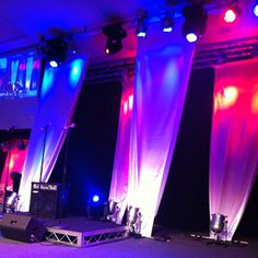 Inspire Conference:  2012 CityLife Church White satin banners using lighting to give effect