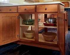 The double sided cabinet design of Aristokraft's peninsula cabinet provides easy access to your cooking utensils or serving dishes.