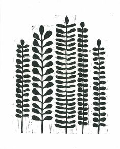 Delicate fern leaflets rise up to the top of this black and white botanical…