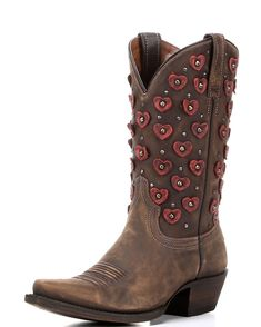 The Belle Heart Boot is a look maker with her leather heart punches, many studs, and saddle brown leather. Our unique finishing gives each pair its own look. The finishing touch is a heart inlay at the heel that's sure to entice.