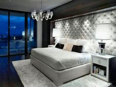 Forget a headboard, they have a whole tufted wall....nice!!!!