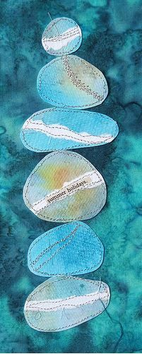 Watercolour pebbles machine stitched to hand-dyed cotton fabric by Carolyn Saxby
