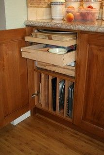 Finally a way to store those baking sheets and cutting boards. #kitchen