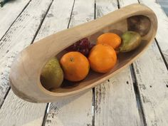 This reclaimed teak root platter features a beautiful oval design and handle.  It has a smooth finish giving unique colours within the wood. So many things you could add to this lovely bowl, fruit, nuts, bread, flowers, candles.......how about full of herbs and displayed on the kitchen windowsill