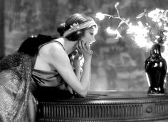 1920s lady leaning on dresser