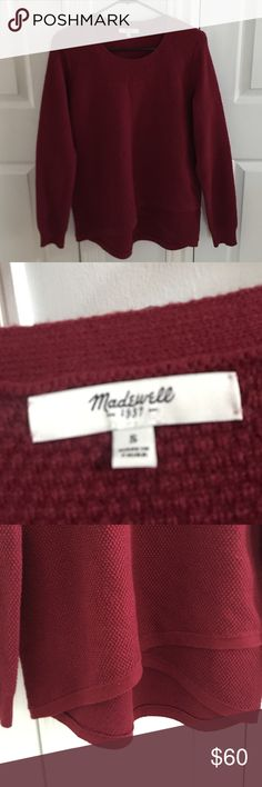 Never worn sweater from Madewell. This maroon/red sweater from Madewell is comfortable and warm for this fall and winter. Not thin material. Perfect length, slightly longer in the back. Cute crisscross in the front. Madewell Sweaters