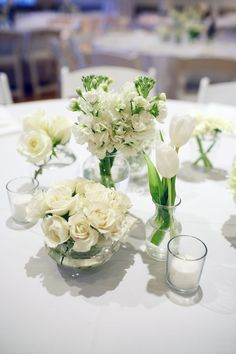 All White Wedding Centrepieces - like the variety on one table