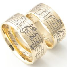 Matching Pair Of Musical Notes Hand Engraved Wedding Rings Set In Yellow Gold Personalised With Their Favourite Piece Music