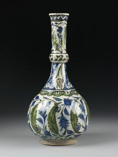 Tall white bottle with large green leaves and smaller blue ones, Turkey (Iznik), ca. 1545-1550.