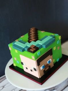 Looking to make a Minecraft cake? These 25 different Minecraft birthday cake ideas will give you plenty of inspiration, from easy to make frosted cubes to elaborate world scenes. Bolo Fake Minecraft, Minecraft Torte, Pastel Minecraft, Minecraft Birthday Cake, Easy Minecraft Cake, Cake Birthday, Minecraft Crafts, Minecraft Ideas, Pink Birthday