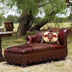 Black cherry leather chaise combines smooth and intricately tooled leathers, nailhead trim, bun feet.  www.krsaddleshop.com